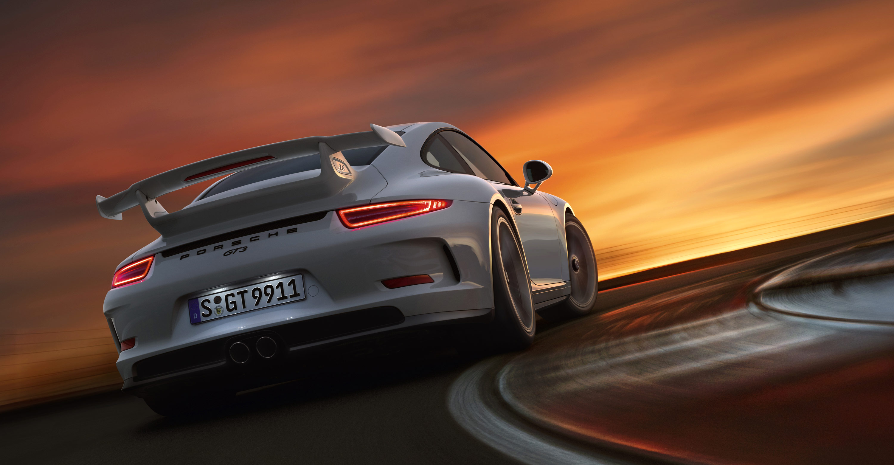 Porsche  Gt In Arctic Silver On Race Track Photographed At High Speed